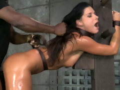 Thonged and oiled-up up brunette MILF India Summer gets her cunt fucked