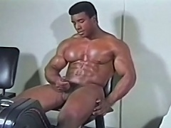 Attractive darksome gay getting his big knob hard while exercising...