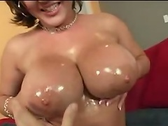 Large titty porn model Claire Dames plays with her giant meatballs and finger...