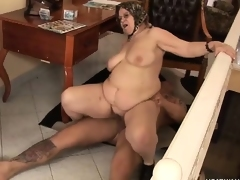 Naughty obese grandma working on the cock of a giant tattooed stud