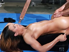 A brunette become absent-minded has a low-spirited jet ass is screwed in the gym earnest