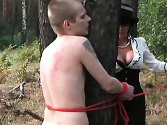 Two women hinder three men outside working and turn them into sex slaves