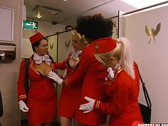 Gorgeous stewardess attacked by a randy cohort in a toilet