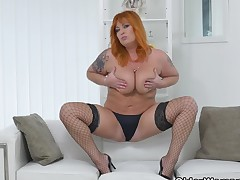 Fire red hair milf Alex strips off and fingers will not hear of mature pussy