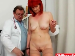 Doctor gives redhead an anal exam