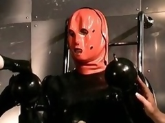 Strange Dominatrices With a Latex Fringe Suffocate a Submissive Male